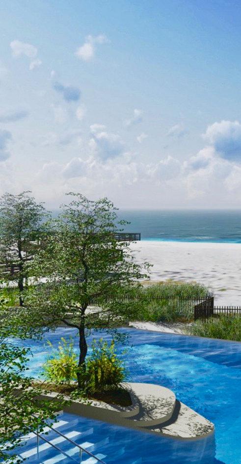 pool overlooking beach and ocean
